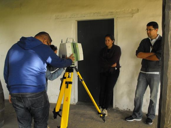 The USF-CyArk team trains the Leica C10 3D laser scanner on the walls of the Mission Adobe during the March 21 scanning session. Hannah Moore photo.
